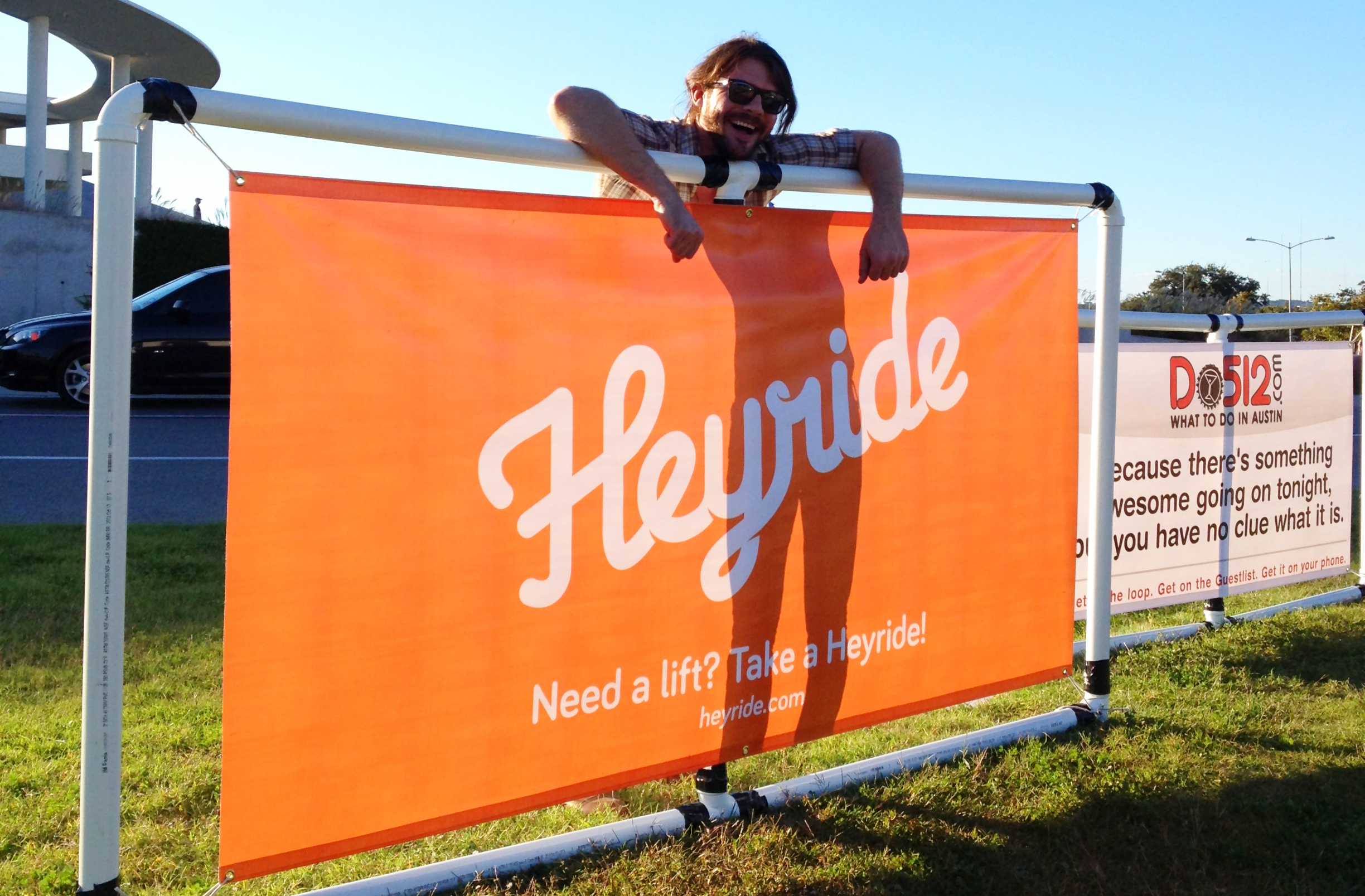 Josh posing with the Heyride banner at FunFunFun Fest.